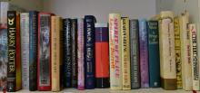 A SHELF OF MODERN FIRST EDITIONS INCL. JK ROWLING AND GRAHAM GREEN