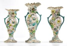 A SET OF THREE CONTINENTAL FLORAL ENCRUSTED VASES