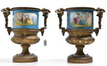 A PAIR OF FRENCH PORCELAIN AND BRONZE URNS (NOW WITH COVER)