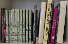 A SHELF OF ART BOOKS INCLUDING MICHELANGELO AND IMPRESSIONIST PRINTS AND LUXE II