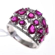 A TREATED RUBY AND DIAMOND RING IN 18CT WHITE GOLD
