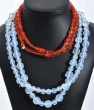 TWO OPALESCENT NECKLACES TOGETHER WITH A RED BEAD NECKLACE