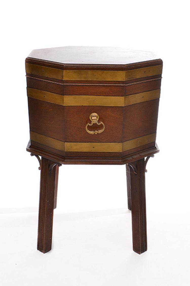 A MAHOGANY OCTAGONAL CELLARETTE ON STAND