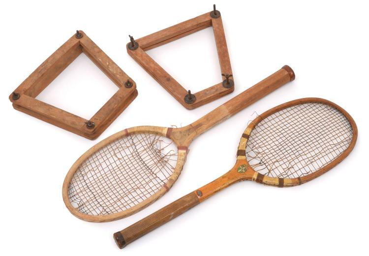 TWO WOODEN TENNIS RACQUETS WITH PRESSES INCL. SLAZENGER (UK) C.1905-1920; & A H.J. & SONS (UK) C.EARLY 1930'S, BOTH WITH SCORED HANDLES