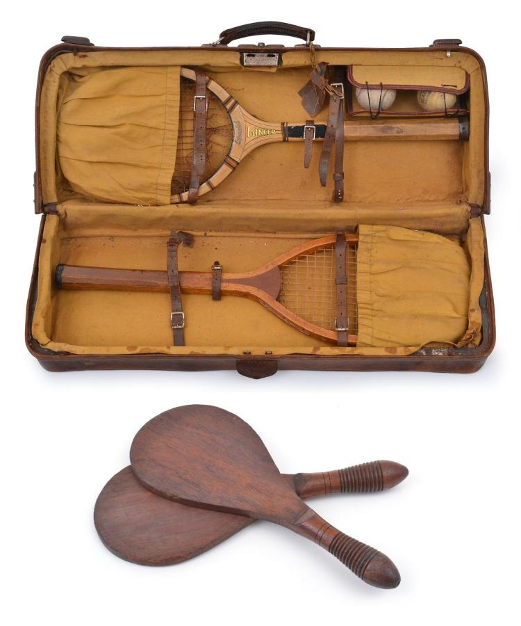 TENNIS HOLDALL 'SOLID LEATHER' WITH RACQUETS & BALLS, C.1912 WITH JUNIOR & SENIOR TENNIS RACQUETS; WITH A PAIR OF WOODEN PING PONG B...