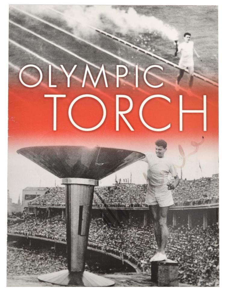 1956 MELBOURNE OLYMPIC TORCH COMMEMORATIVE PENNY BROCHURE; SIGNED RON CLARKE