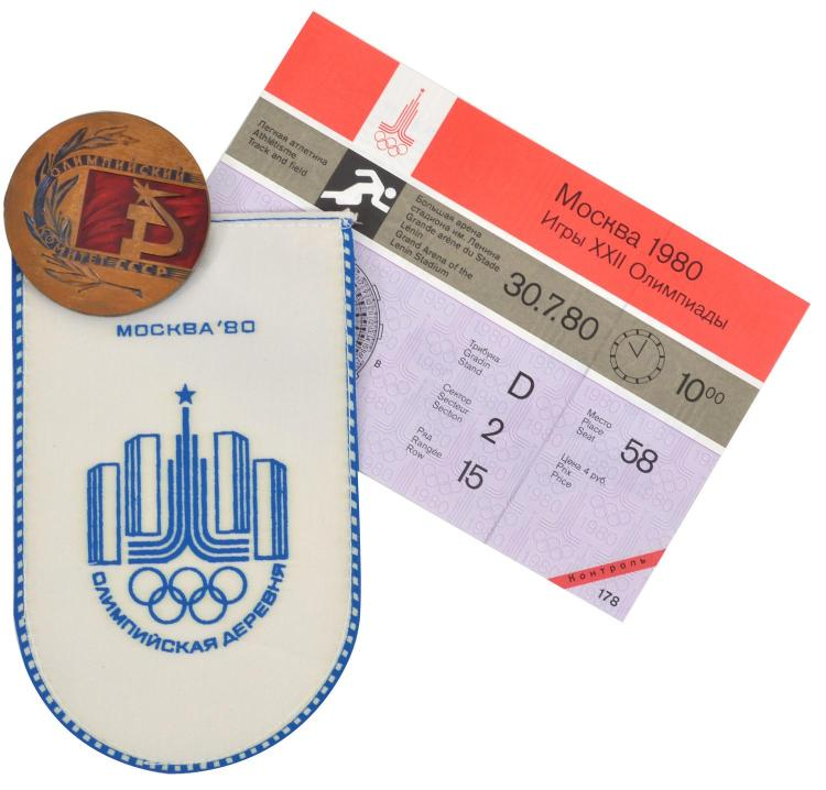 A 1980 MOSCOW OLYMPIC GAMES PARTICIPATION MEDAL WITH WOVEN FLAG AND ATHLETICS TICKET