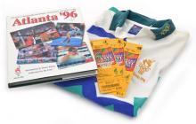 ATLANTA '96 OFFICIAL COMMEMORATIVE BOOK WITH THREE TICKETS TO THE GAMES AND A VOLUNTEER SHIRT