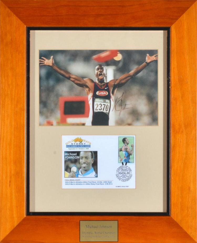 1996 ATLANTA OLYMPIC GAMES FRAMED AUTOGRAPHED PHOTO OF MICHAEL JOHNSON- GOLD MEDALLIST 200M & 400M