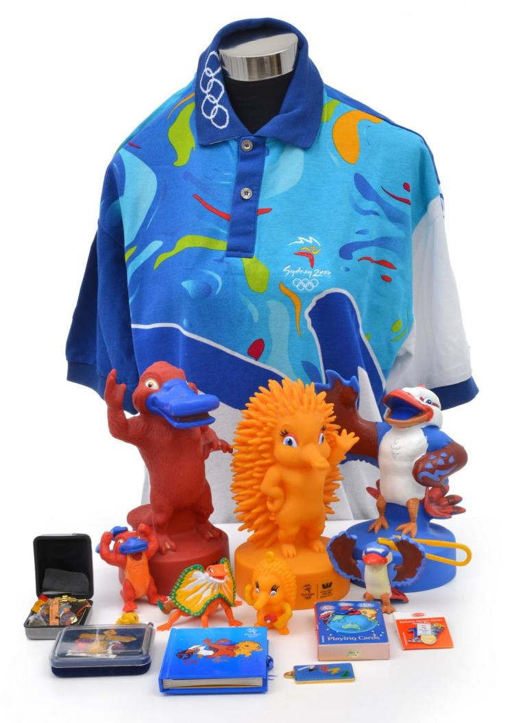 2000 SYDNEY OLYMPIC GAMES MEMORABILIA COLLECTION INCL. MONEY BOX MASCOTS, PINS AND PLAYING CARDS, WITH OLYMPIC VOLUNTEER SHIRT