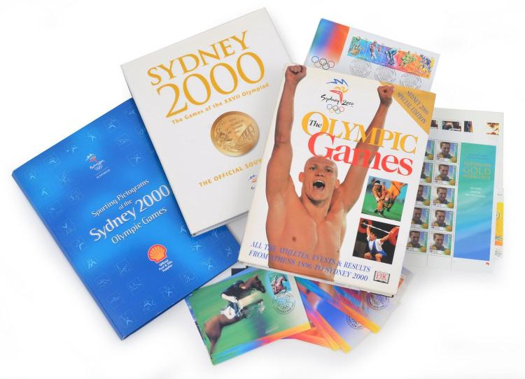 A LARGE COLLECTION OF BOOKS, STAMPS AND FIRST DAY COVERS FROM THE SYDNEY 2000 OLYMPIC GAMES