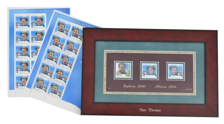 IAN THORPE FRAMED STAMP-ART COMMEMORATING ACHIEVEMENTS AT SYDNEY AND ATHENS OLYMPICS WITH TWO PAGES OF 10 STAMPS FROM ATHENS 2004