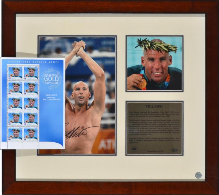 FRAMED AUTOGRAPHED PHOTO OF GRANT HACKETT FROM THE 2004 ATHENS OLYMPIC GAMES WITH PAGE OF 10 COMMEMORATIVE STAMPS