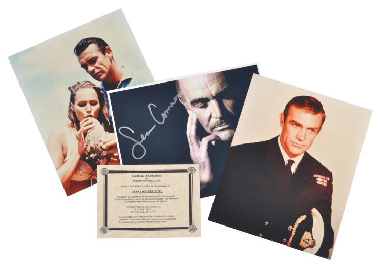 SEAN CONNERY AS JAMES BOND; THREE COLOUR PHOTOGRAPHS, ONE OF WHICH IS AUTOGRAPHED