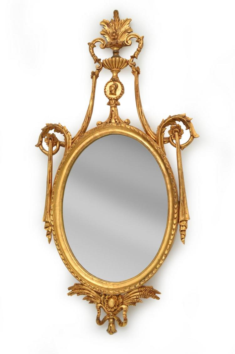 A REGENCY STYLE GILT WOOD FRAMED OVAL WALL MIRROR