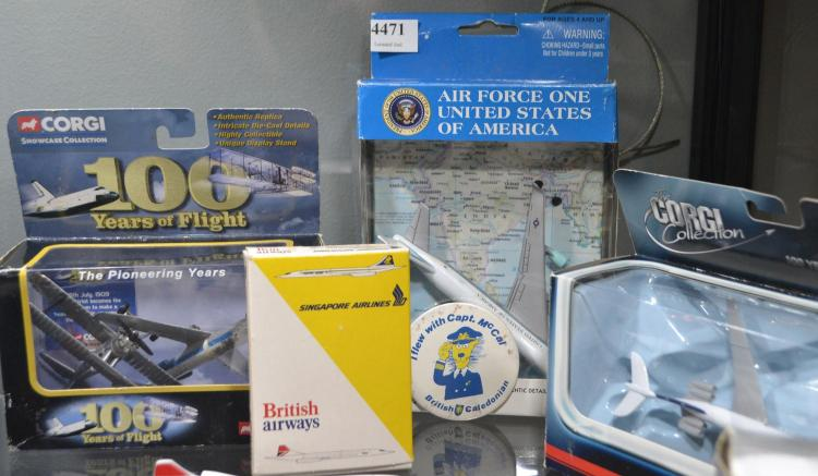 TWO CORGI AIRLINE MODELS, AIRLINE BADGE AND AN AIRFORCE ONE MODEL