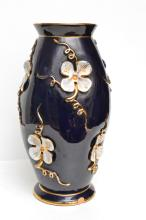 ITALIAN CERAMIC VASE, NAVY BLUE GROUND, WITH APPLIED FLORAL DECORATION, (CHIP TO FOOT RIM)