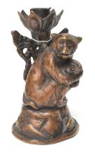 A CHINESE BRONZE MONKEY WITH BABY CANDLE HOLDER. FOUR PETAL FLOWER MARK TO BASE. HEIGHT 11.5CM