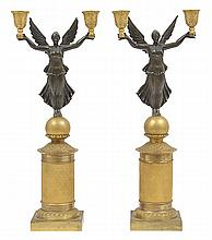 A PAIR OF BRONZE AND GILT BRONZE WINGED VICTORY CANDELABRA