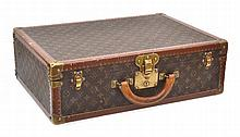 A SMALL BISTEN SUITCASE BY LOUIS VUITTON