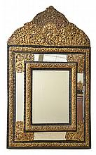 AN EMBOSSED  BRASS MOUNTED CUSHION FRONT WALL MIRROR
