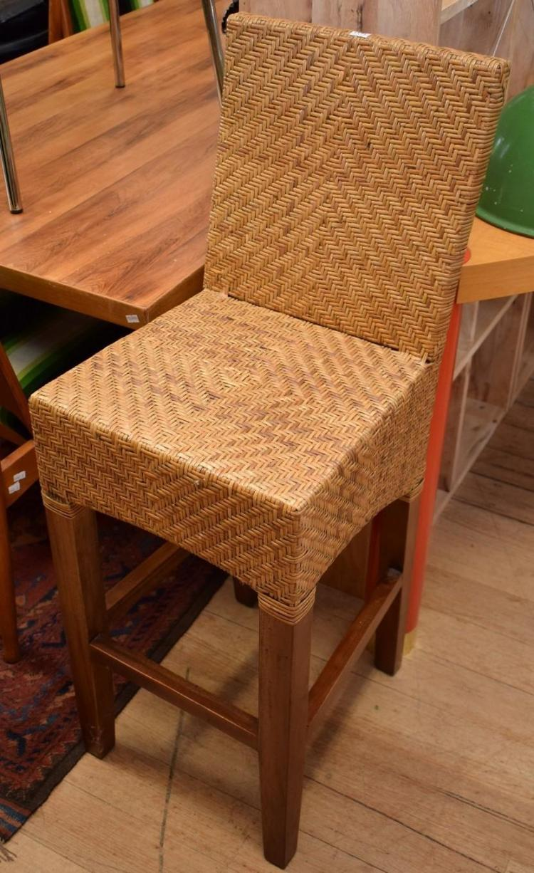 A pair of wicker bar stools