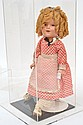 IDEAL SHIRLEY TEMPLE COMPOSITE DOLL, CRACKING TO SURFACE, GLASS WEIGHTED EYES, RED CHECKERED DRESS, BLUE BOW, IN GLASS CASE