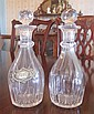 A PAIR OF 19TH CENTURY FACETED CRYSTAL DECANTERS, 25CM HIGH