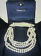 A TIFFANY AND CO BEADED NECKLACE, MULTI-STRAND IN STERLING SILVER, BOXED.