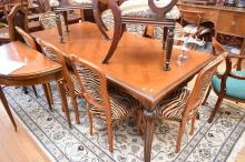 A FRENCH PROVINCIAL STYLE PARQUETRY TOP DINING TABLE (structure faults to leg)