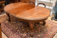 A CHIPPENDALE STYLE MAHOGANY EXTENSION DINING TABLE (with three leaves)