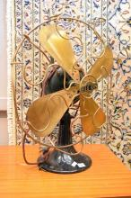 AN EARLY 'ELCON' BRASS AND IRON TABLE FAN