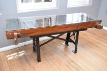 AN INDONESIAN ANTIQUE TIMBER DOOR CONVERTED GLASS TOP TABLE (H88xW204xD67cm)