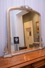 A SILVER PAINTED OVERMANTLE MIRROR