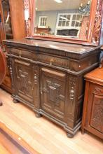 A FRENCH HENRY II OAK STYLE CARVED TALL DARK SIDEBOARD