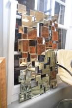 A CONTEMPORARY MULTI PANEL MIRROR WITH BEVELLED EDGES
