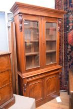 A LATE VICTORIAN CEDAR DOUBLE BODIED GLAZED BOOKCASE