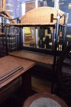A WROUGHT IRON SHELVING UNIT
