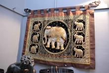 A DECORATIVE EMBROIDERED INDIAN WALL HANGING