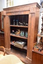 A TALL OPEN BOOKSHELF MADE FROM A REPURPOSED ANTIQUE DOORFRAME