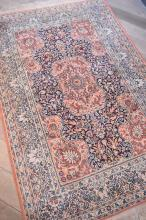 A PERSIAN SILK TEXTURED NAVY & MAEVE CARPET IN FLORAL AND BIRD PATTERN (190 CM X 121)