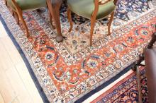 A PERSIAN STYLE CARPET WITH RED BORDER AND BLUE MEDALION ( 360CM x 275CM )