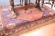 A PERSIAN CARPET IN NAVY AND ORANGE PATTERN - signicant moth damage