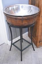 A CHAMPAGNE BUCKET ON STAND