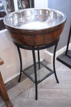 A RUSTIC CHAMPAGNE BUCKET ON STAND