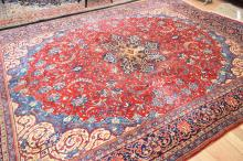 A PERSIAN CARPET IN INTRICATE BLUE AND RED PATTERN, (395 X 295CM)