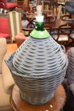 AN ITALIAN MADE WINE GREEN GLASS DEMIJOHN WITH BREWERY ACCESSORIES