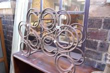 A WROUGHT IRON WINE RACK