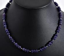A FACETED SAPPHIRE BEAD NECKLACE WITH 14CT GOLD CLASP AND RONDELS