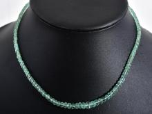 A FACETED EMERALD BEAD NECKLACE WITH GOLD CLASP